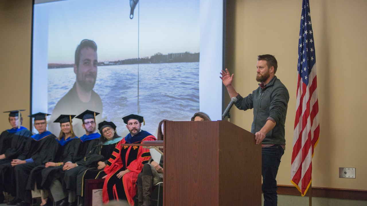 Kyle Kandel speaks to students, faculty and staff at Western Michigan University-Traverse City's graduate recognition ceremony for the freshwater science and sustainability program about his brother Michael Kandel, a student of the freshwater science and sustainability program who passed away following a tragic accident in Sturgeon Bay, July 20, 2017.