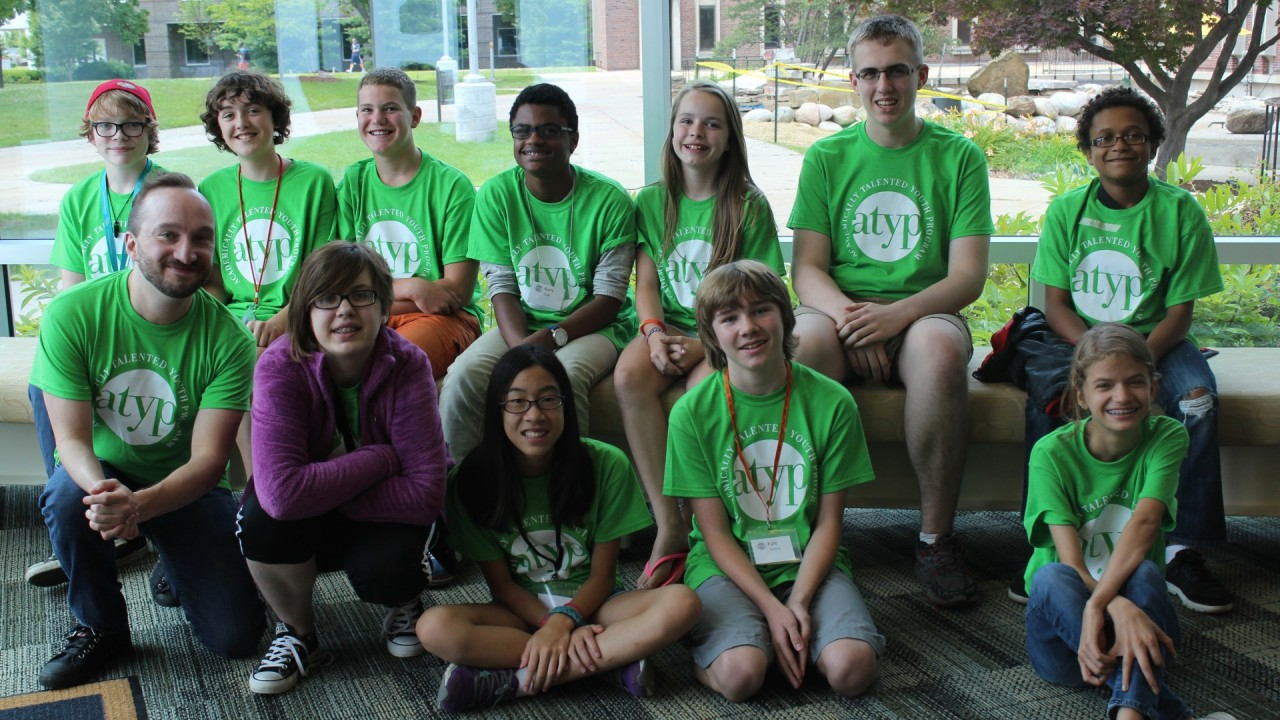 ATYP  summer camp students wearing ATYP shirts and posing in two rows.