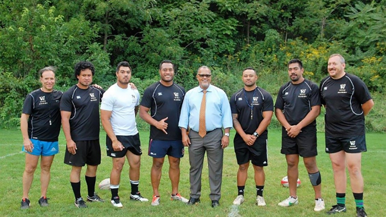 Club Sports men's rugby team with President Montgomery
