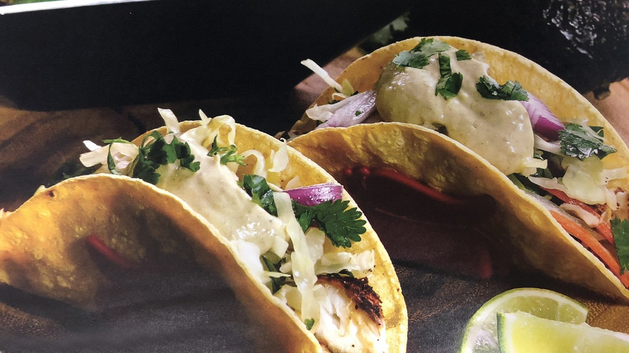 Fish tacos with greens and a side dish of asparagus and mushrooms from Eat Real Cookbook