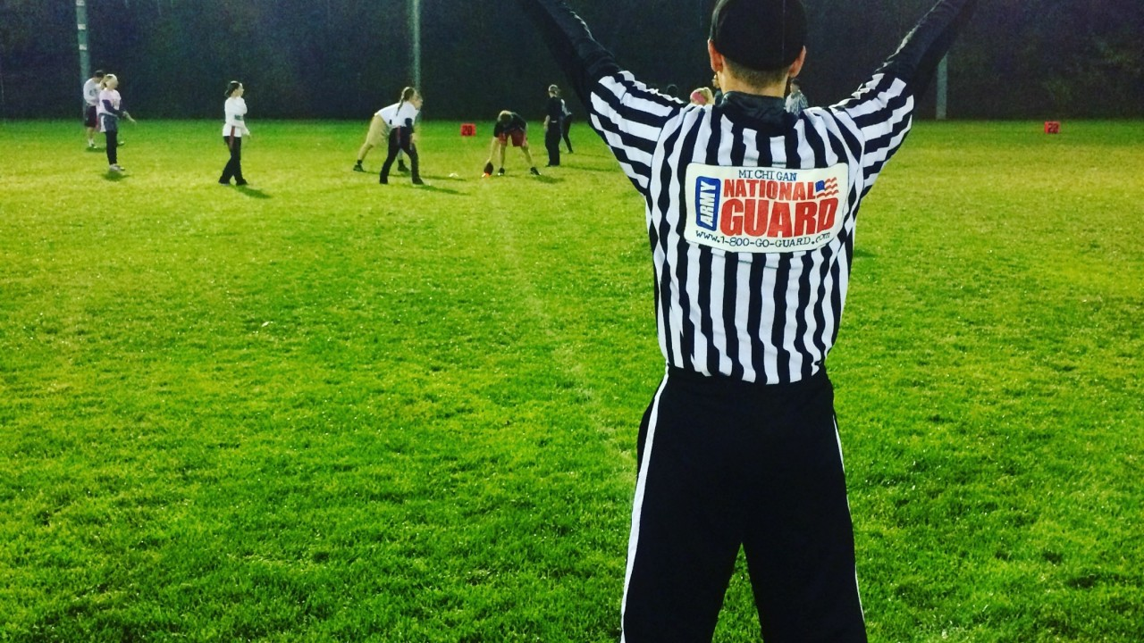 Official working at an outdoor flag football game