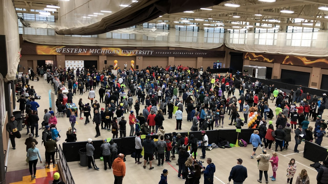 Aerial shot of all Turkey Trot participants taken from the balcony above at the Student Recreation Center