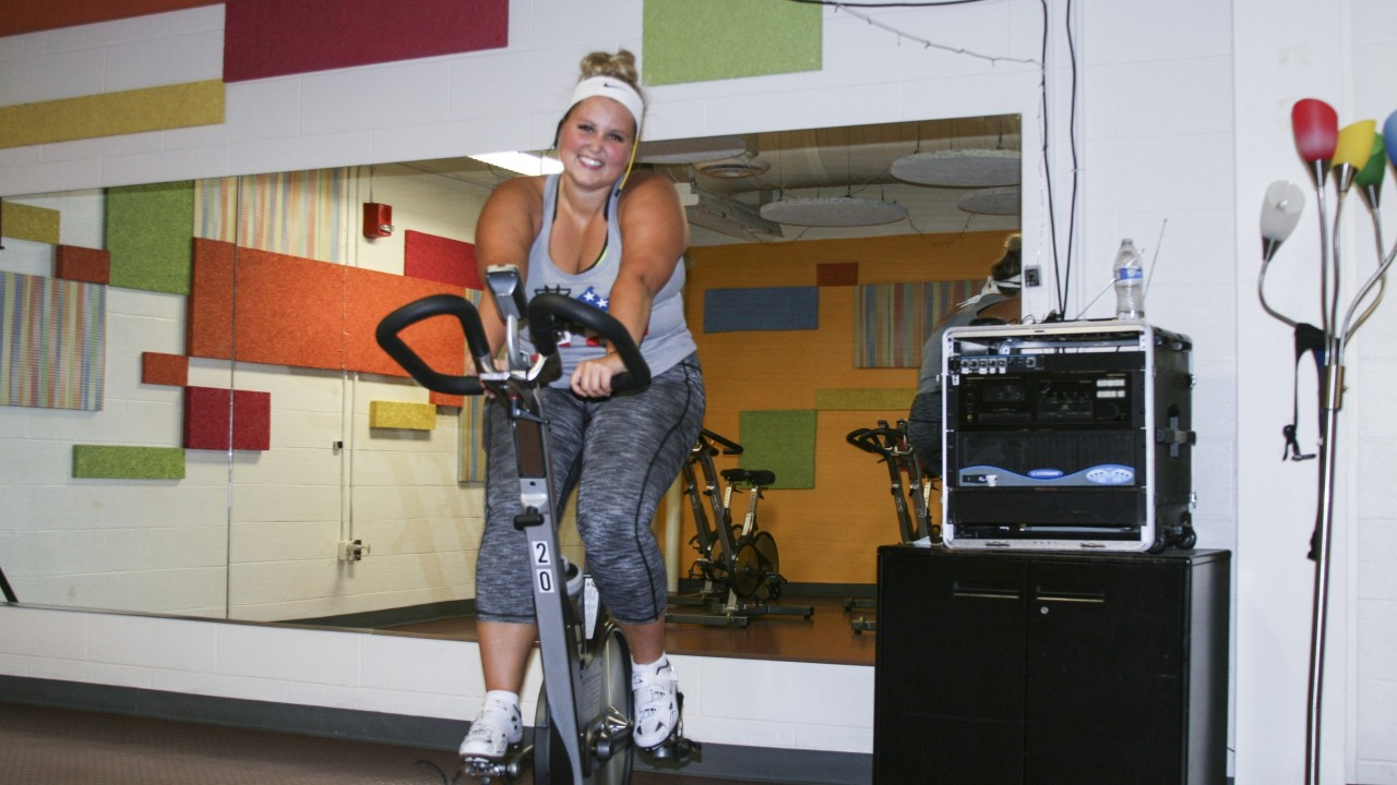 Kennedy smiling and teaching cyclefit