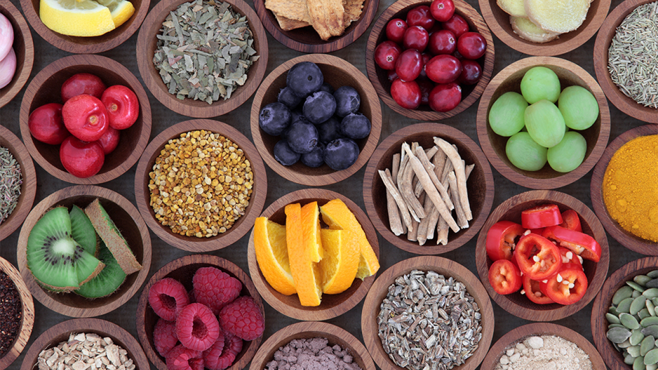 Fruits, vegetables and grains in small wooden bowls