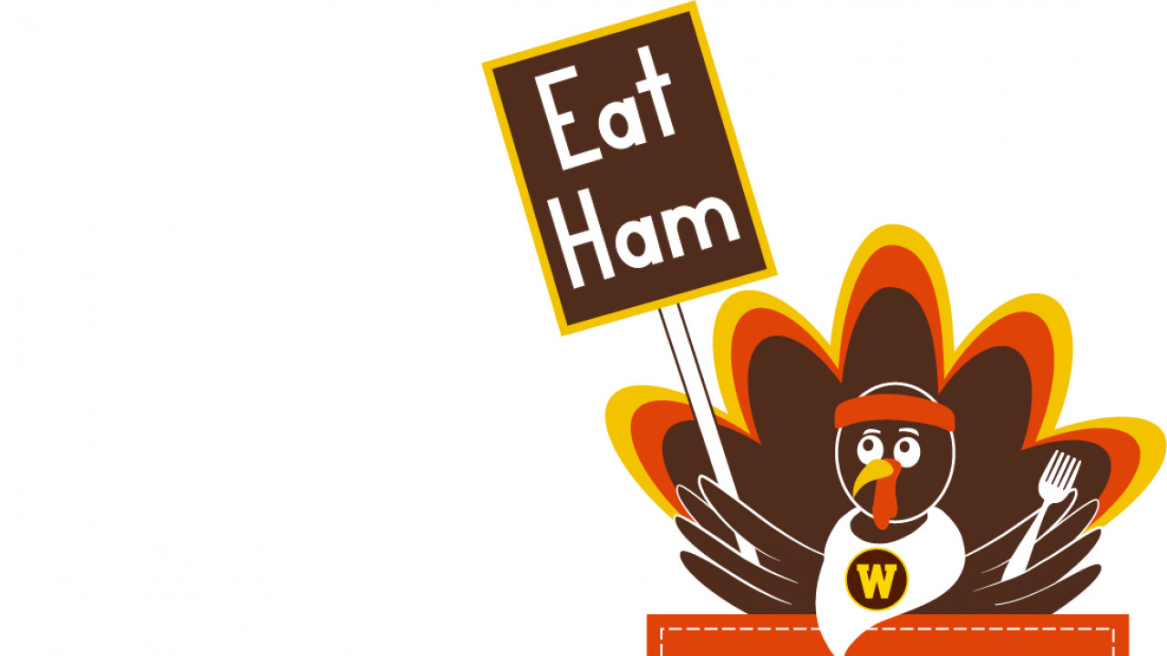 2021 Turkey Trot logo. Turkey is holiding a fork in one. wing and a sign in the other  that says, Eat Ham, Feast Mode