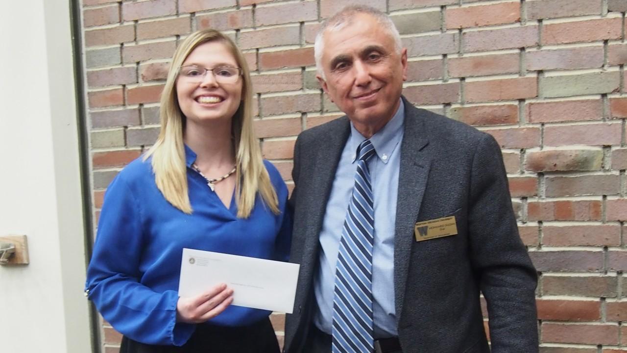 Stephanie Buglione is presented an award