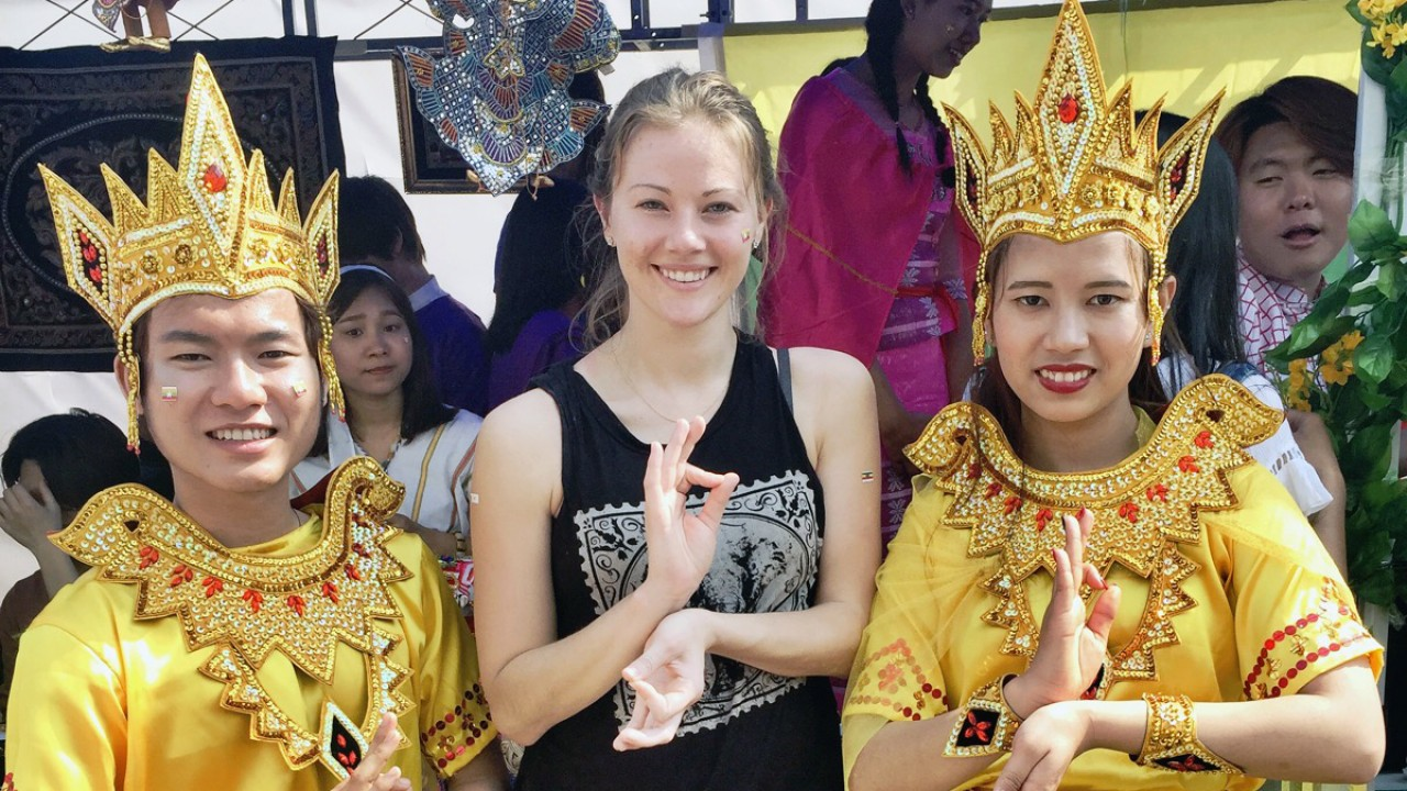 GIST student studying abroad in China with 2 Chinese people in traditional dress.