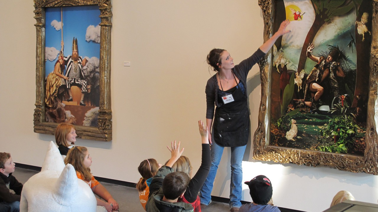 teacher explaining a artwork to children