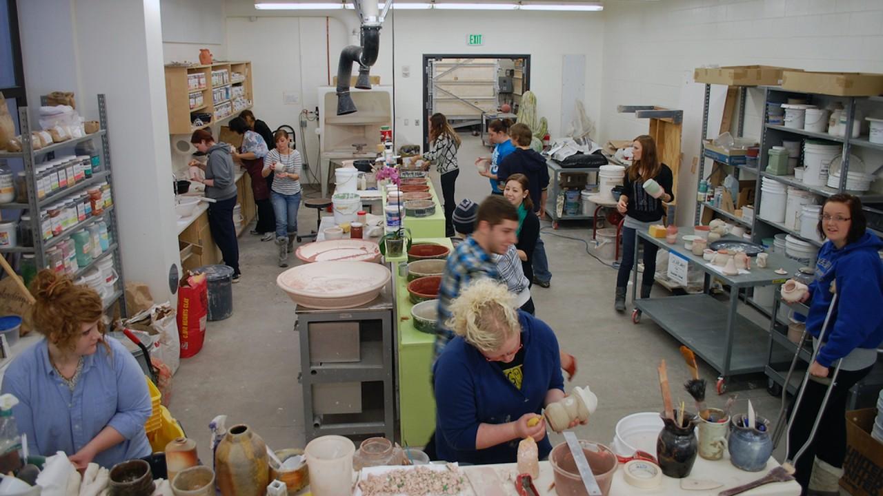 students working in a ceramics studio