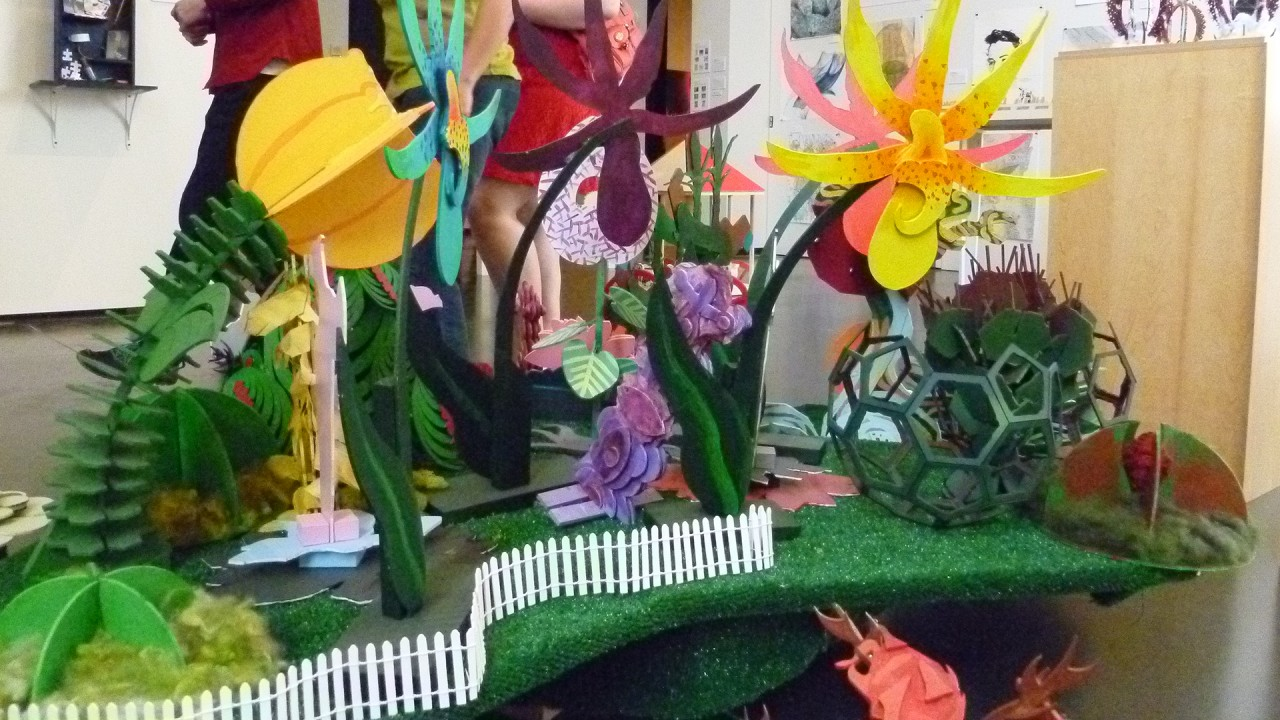 a display of flowers made of paper