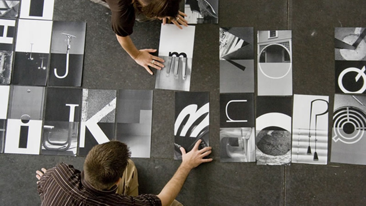 students working on prints with a letter on each one