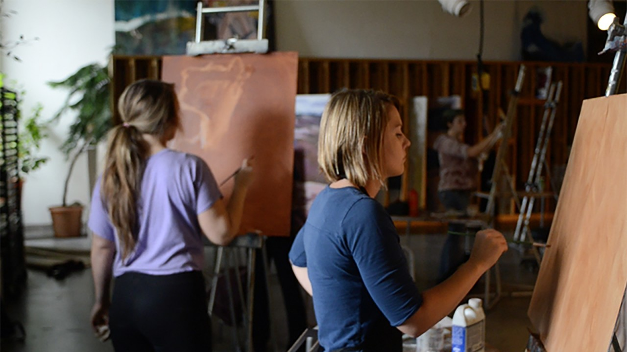 students painting in a studio