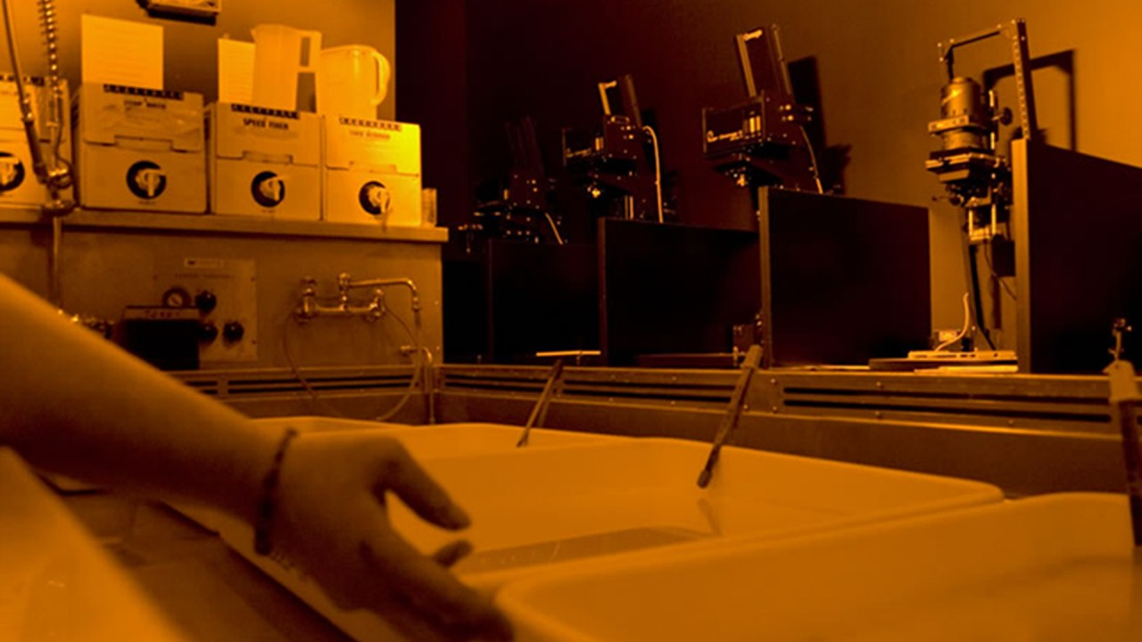 student working in a darkroom