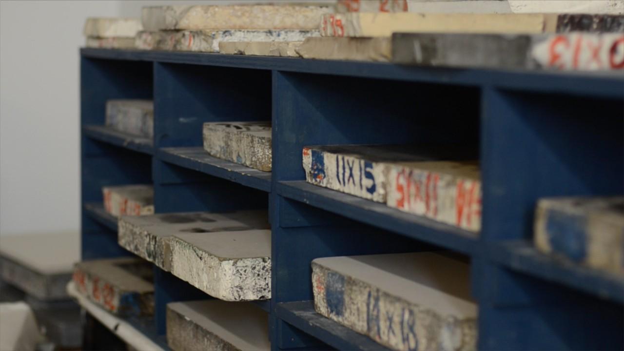 printmedia slabs on blue shelves