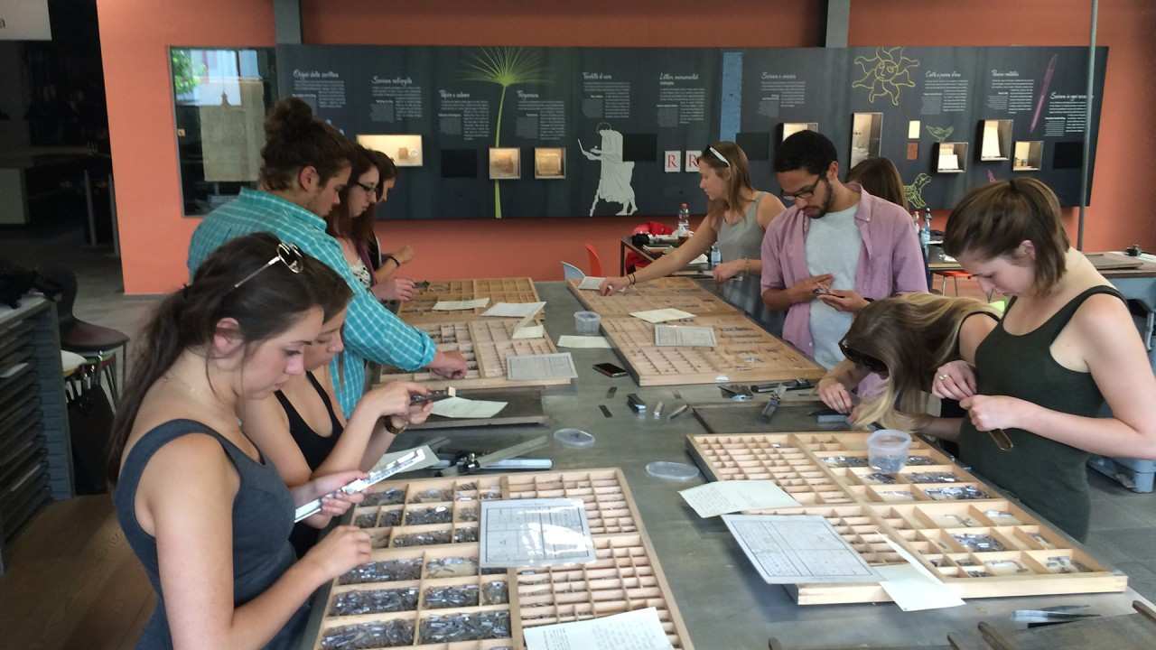 students working with typesetting tools