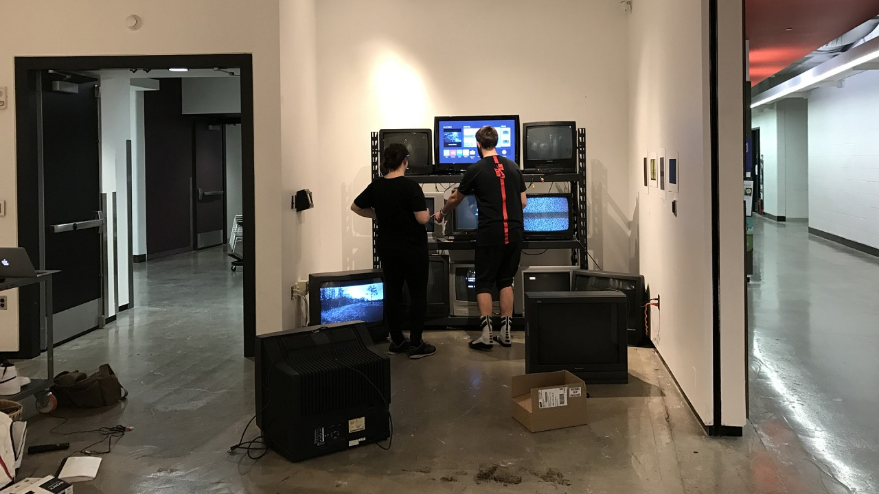 students setting up video installation