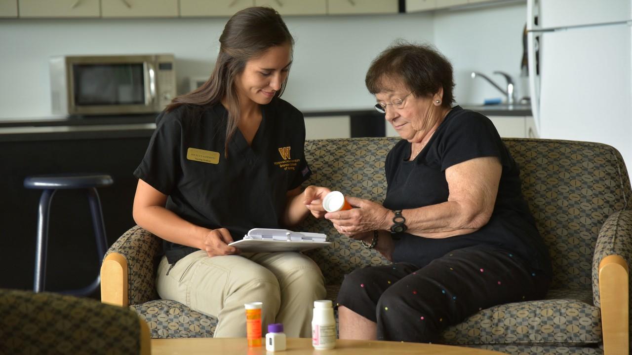 Nursing student with older patient
