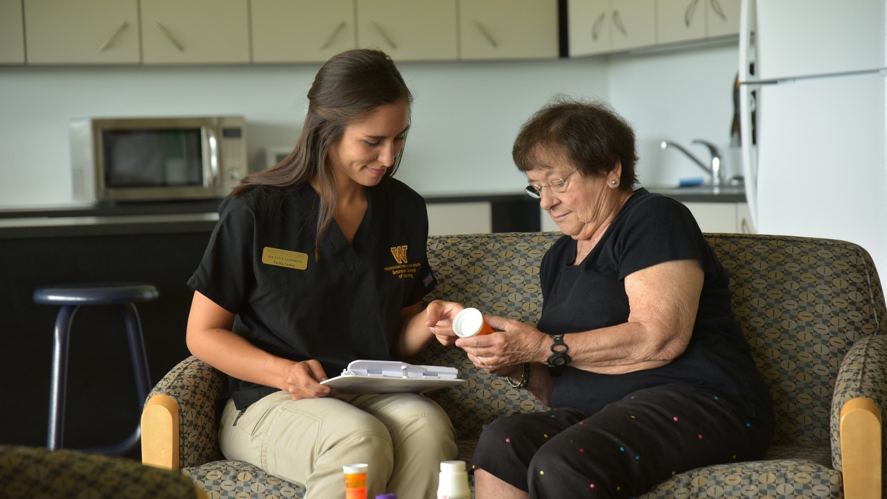 Nursing student with older patient