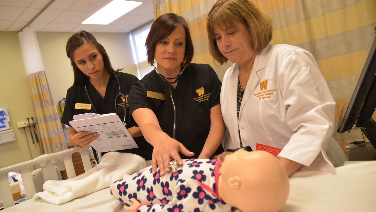 Nursing students with Sim Baby