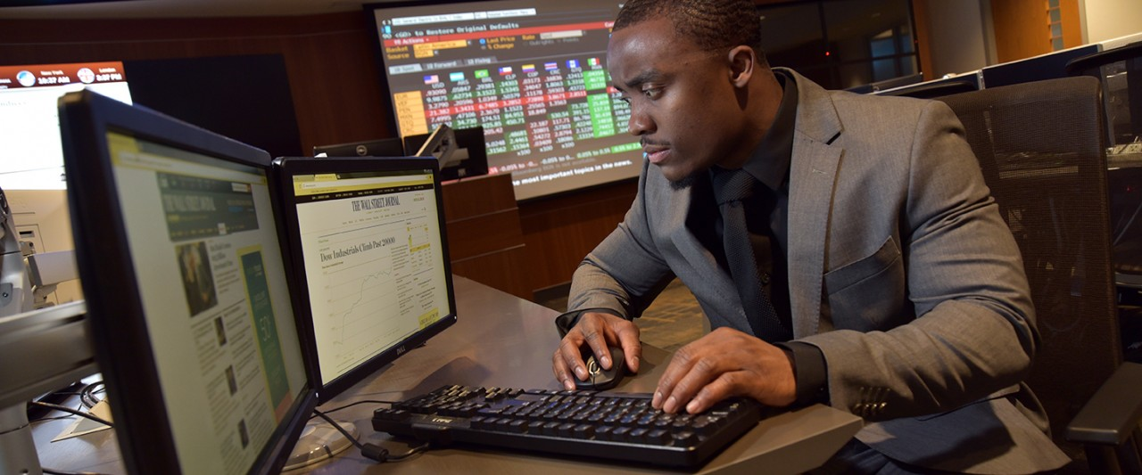 Student in Greenleaf Trust Trading Room