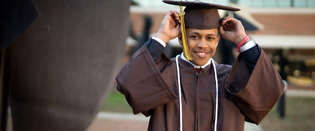 Pictured is JaJuan Kemp in his graduation cap and gown