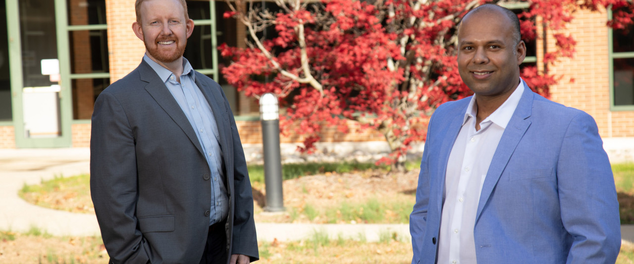 Pictured are Drs. Scott Cowley and Bidyut Hazarika standing outside and socially distanced