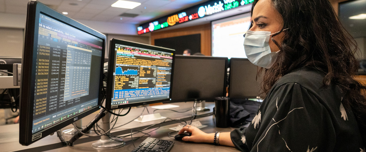 Student sitting at computer in Greenleaf Trust Trading Room at WMU