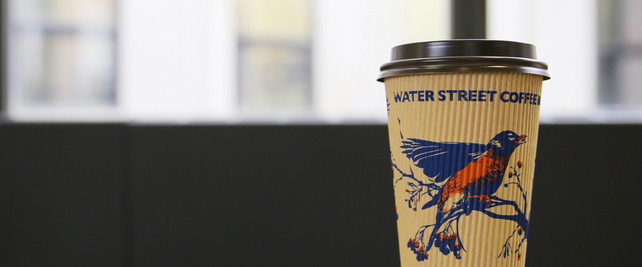 Water Street Coffee Cup on Books