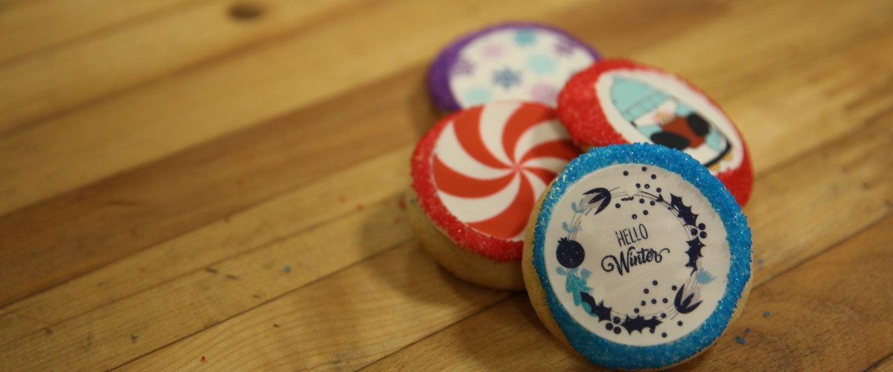 Four winter-themed decorated sugar cookies