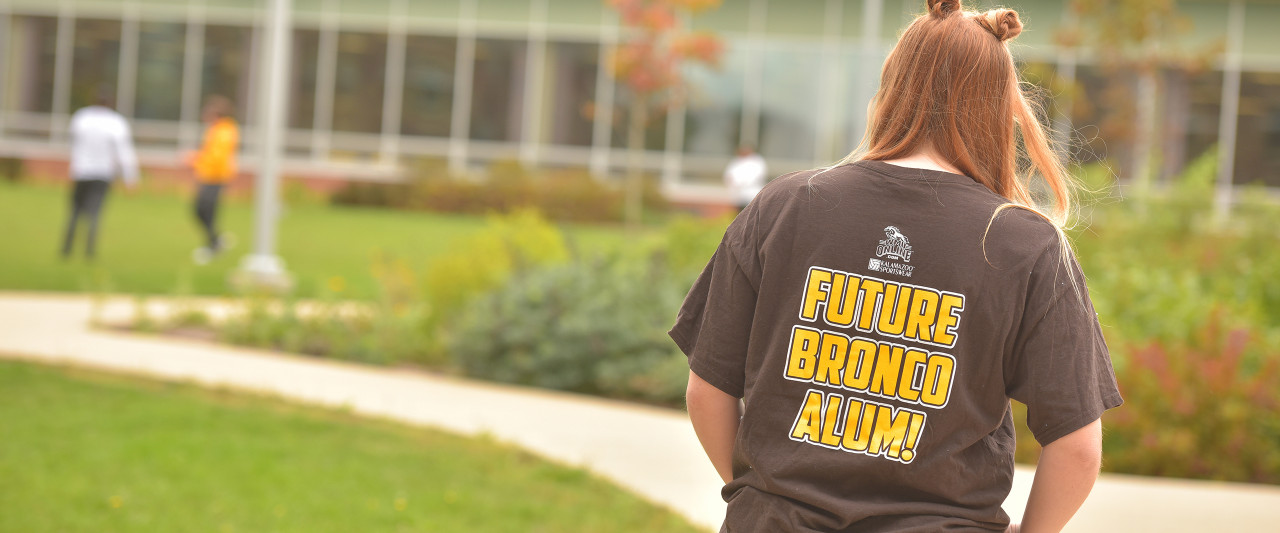 Student on campus wearing Future Bronco Alum tshirt
