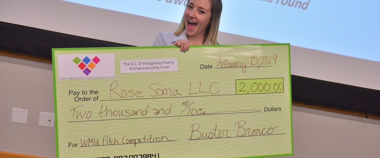Rose Soma holding large winning check