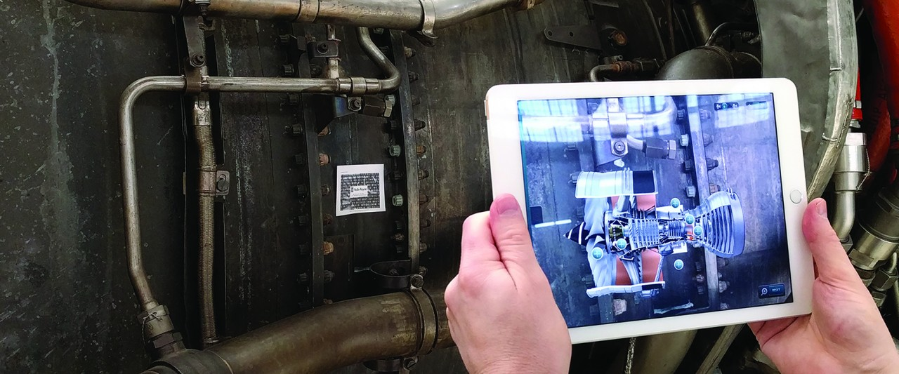 slide of virtual reality of jet engine shown on tablet