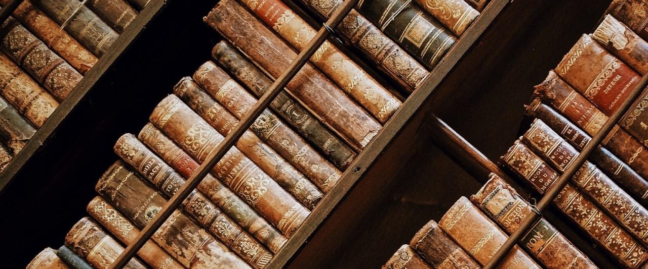 background photo of books on shelf