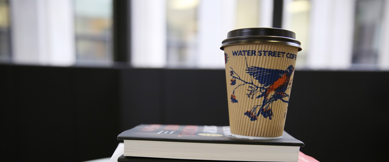 Coffee cup on top of books