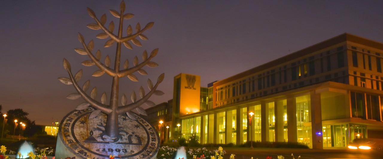 Campus at night, viewing Sangren Hall.