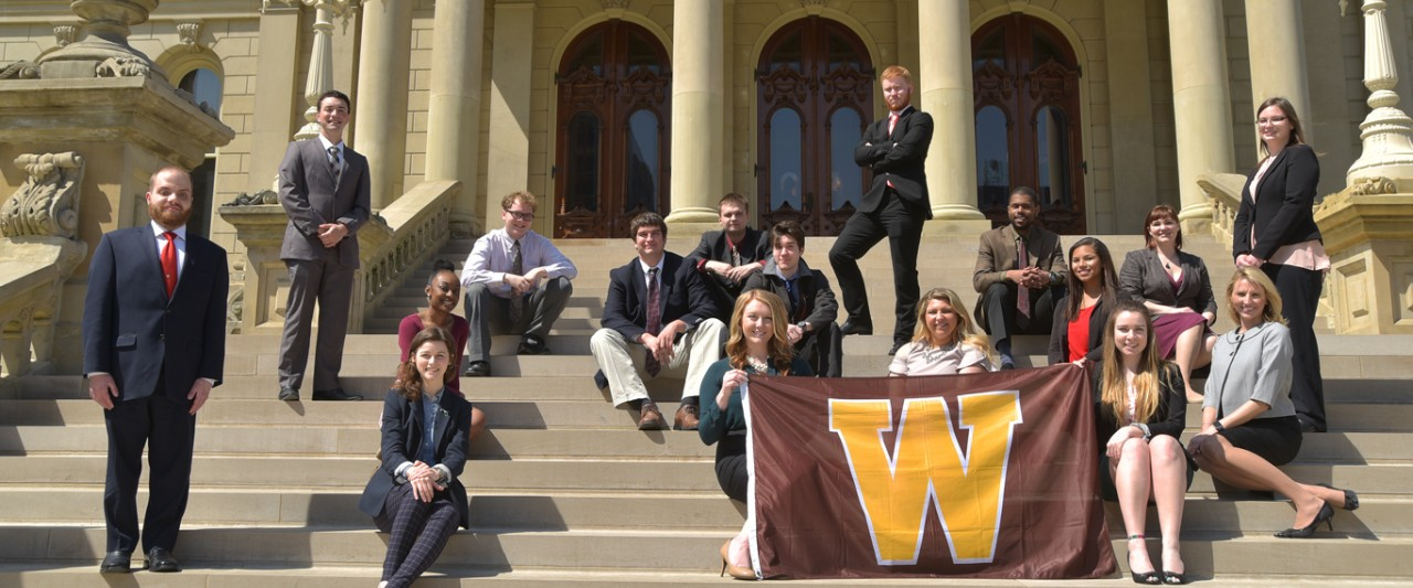 Students in the Capital Intern Program pose for a picture on the steps of the Capitol Building in Lansing, MI