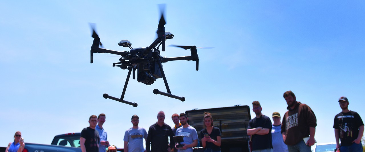 Drone being flown by WMU students outside on a sunny day