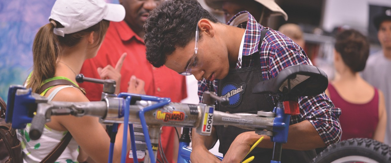 A student building a bicycle.