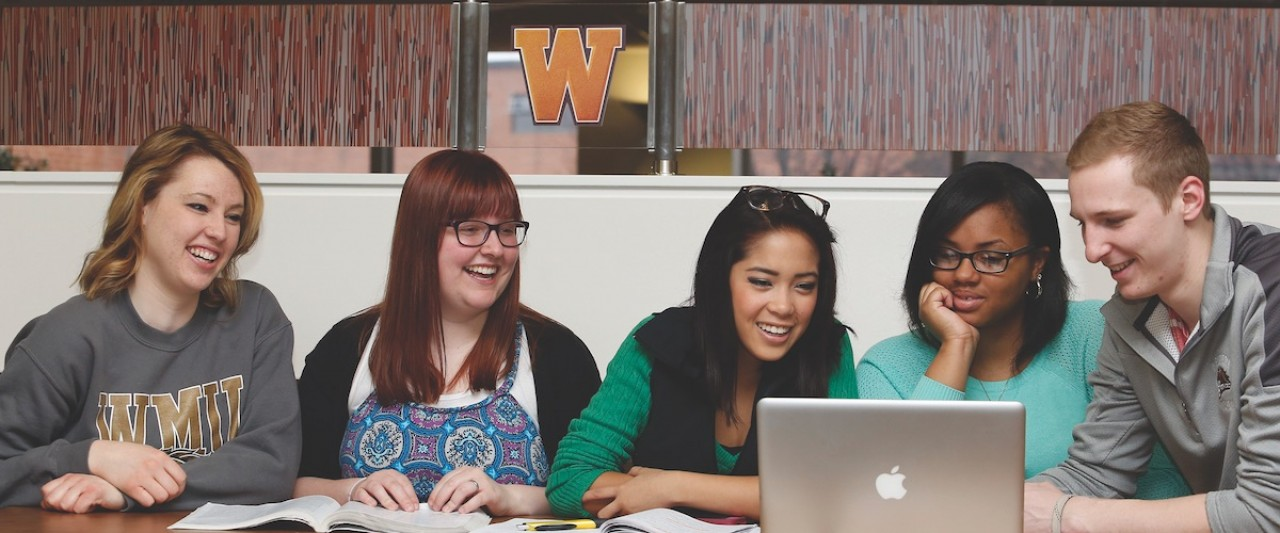 Five students studying with a laptop.