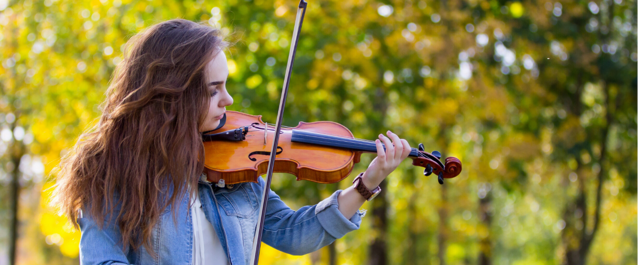 A violin soloist plays outside