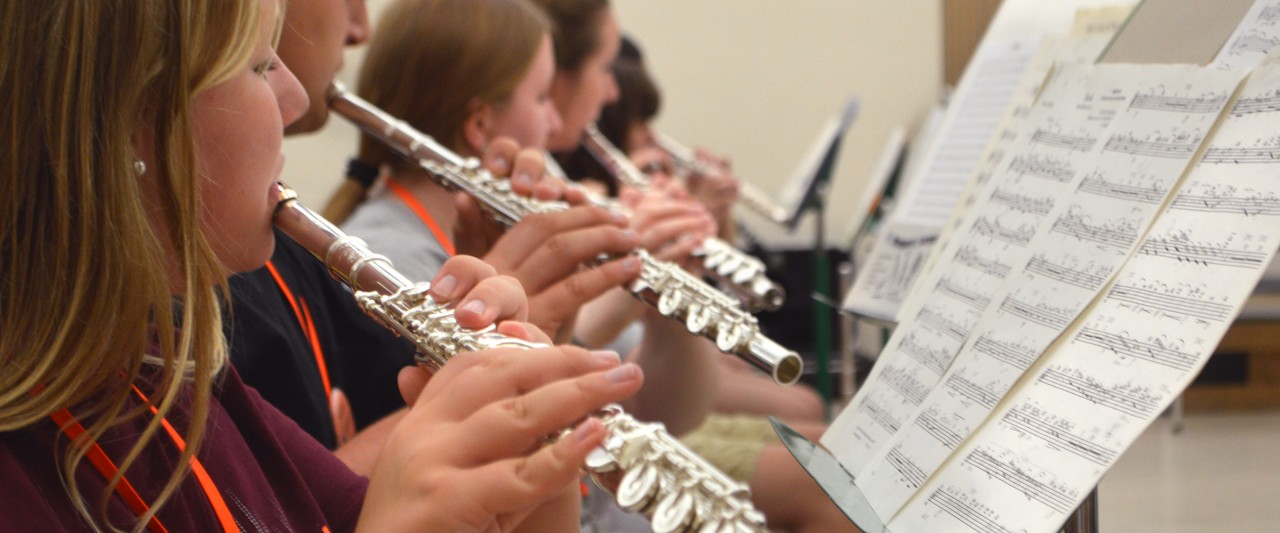 students playing flutes