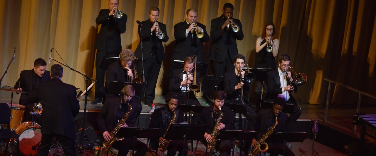 small jazz ensemble with back row of trumpets standing for section feature