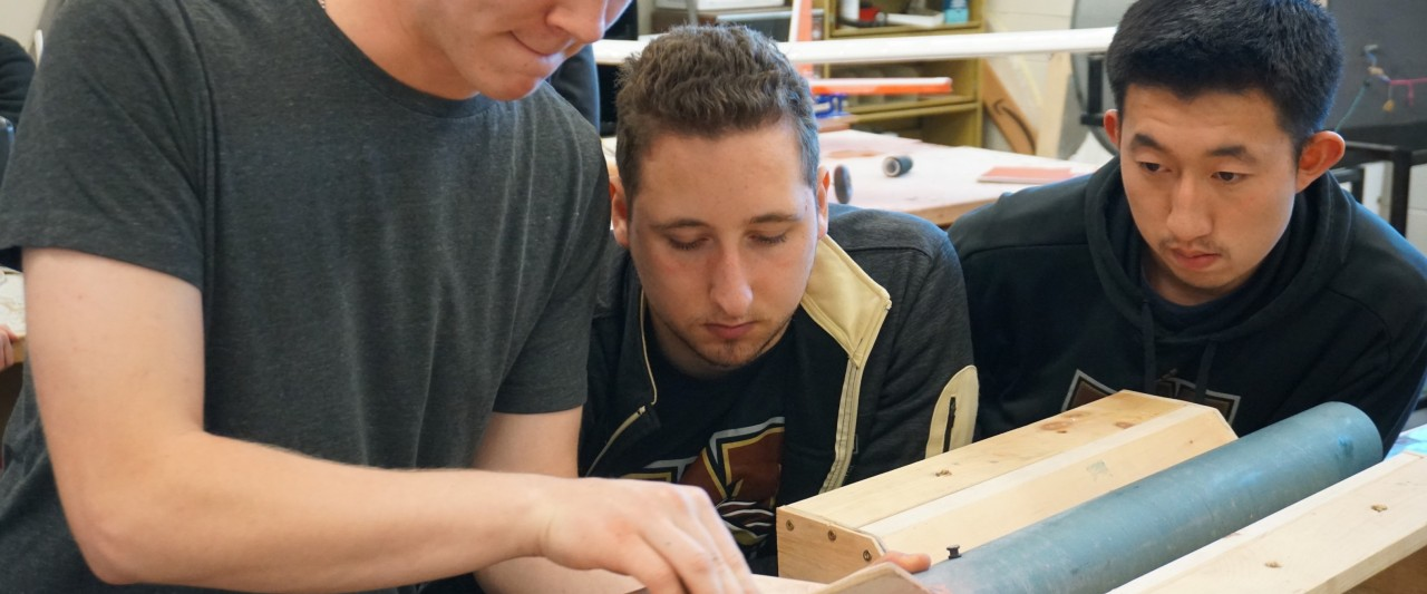 Students build a rocket in a workshop