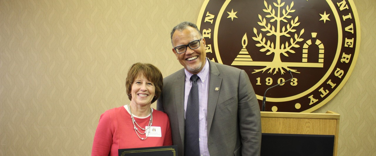 Veterans Affairs Coordinator Brenda Hamlyn posing with President Montgomery after receiving WMU's Semiannual Make a Difference Award