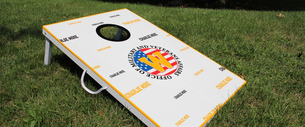 A cornhole platform with the Office of Military and Veterans Affairs' logo imprinted upon it. The game was used during Bronco Bash 2018.