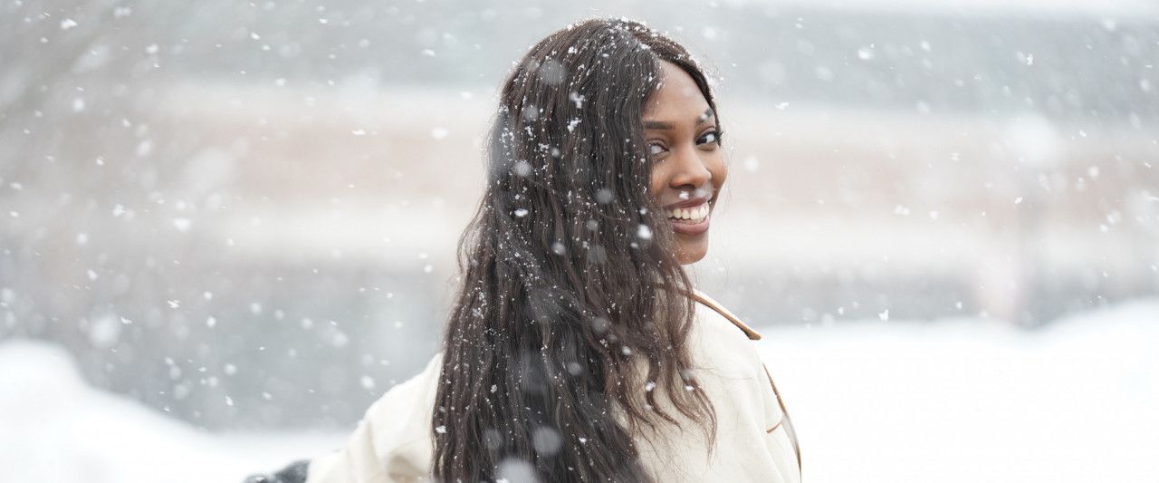 A student twirling in a blizzard