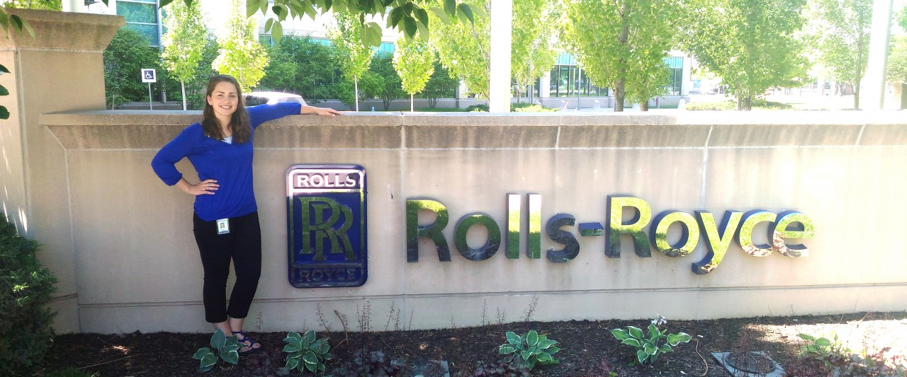 Karlen in front of Rolls-Royce sign