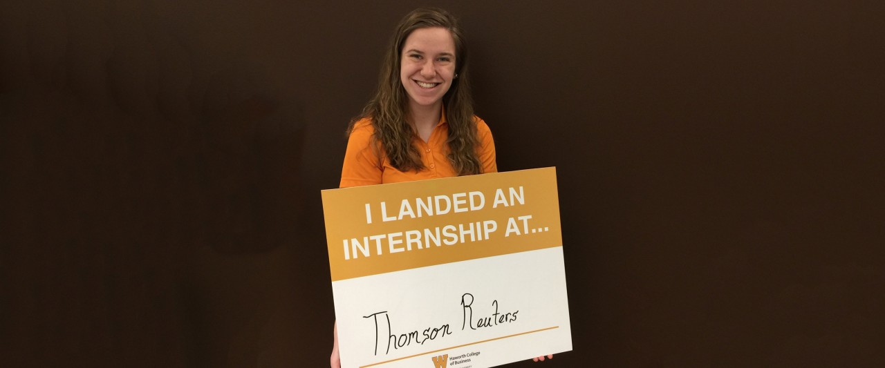 Student holding Thomson Reuters sign
