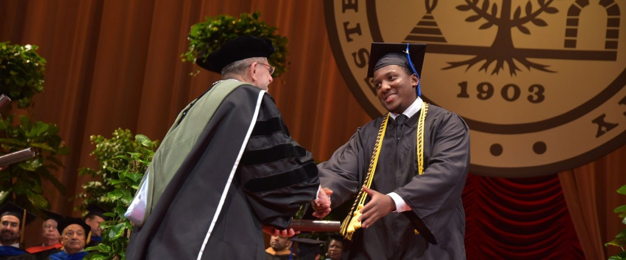 Student on stage at commencement