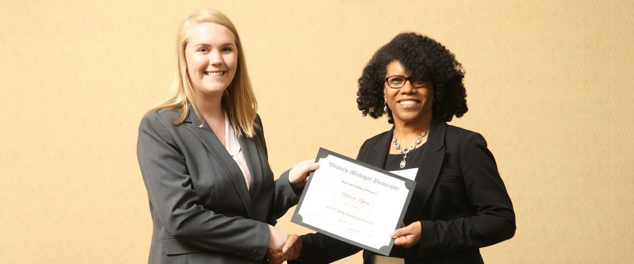 Dr. Ola Smith awards a scholarship to a student